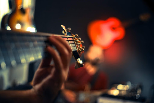 person-playing-guitar-2111856